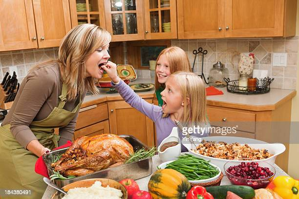 Family Cooking Thanksgiving Holiday Dinner  with Children in Kitchen