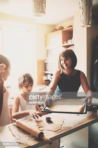 Family cooking together in the morning : Stock Photo