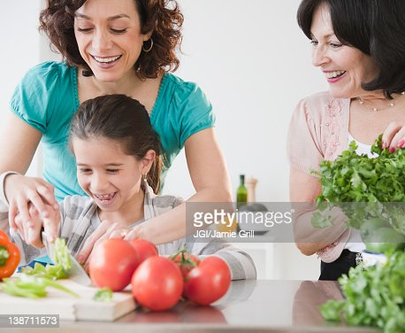 Family cooking together : Stock Photo