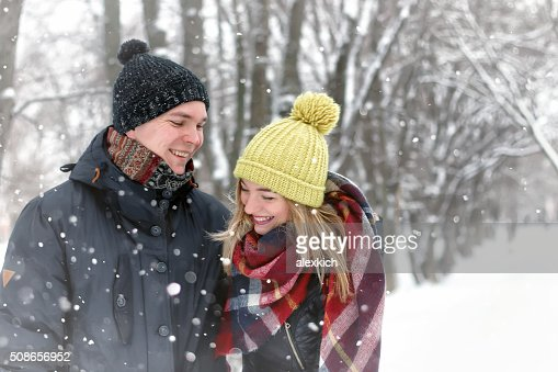 family couple walk winter snow : Stock Photo