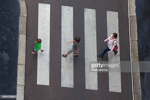family crossing a pedestrian crossing