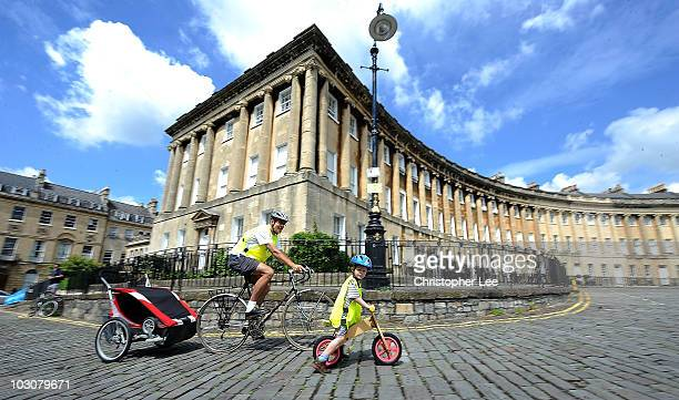 A family cycle along the cobble stones of the Royal Crescent during the Bath SkyRide on July 25 2010 in Bath England