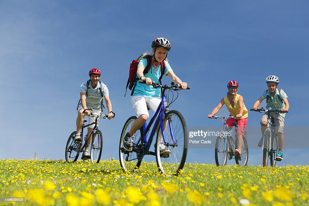 family cycling in field : Stock Photo