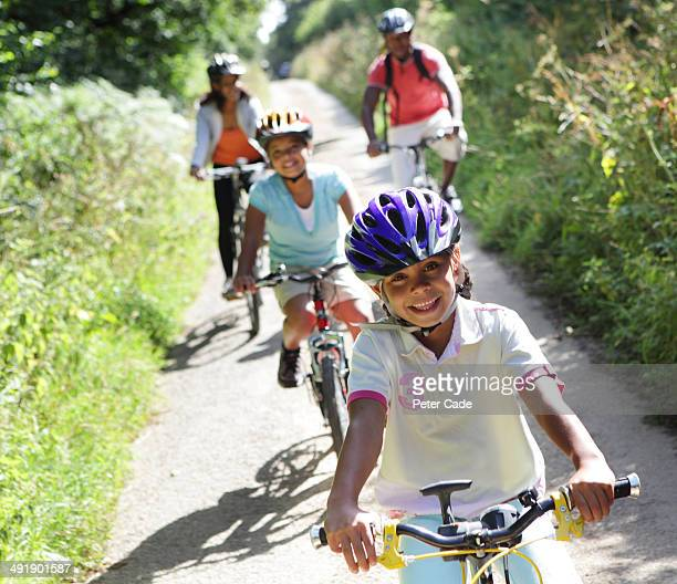 Family cycling on country lane