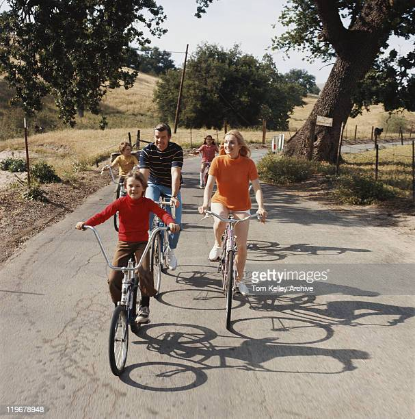 Family cycling on road