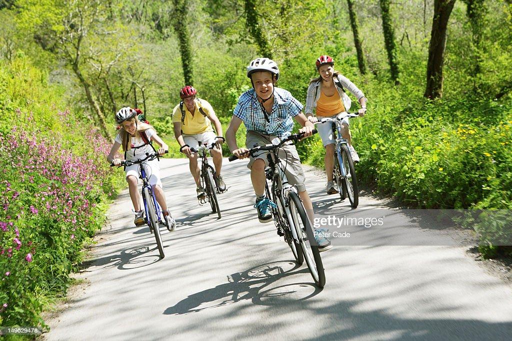family cycling through woodland : Stock Photo
