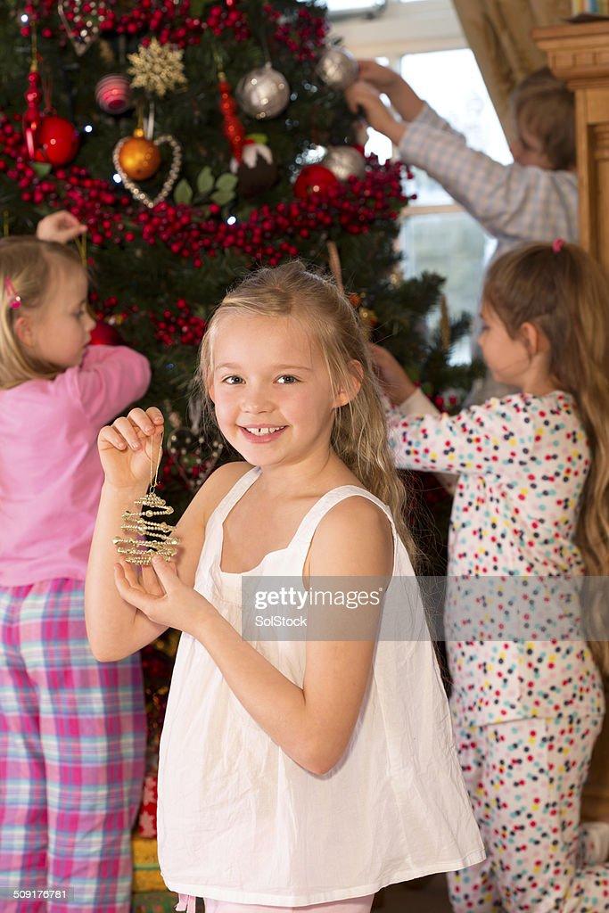 Family Decorating a Christmas Tree : Stock Photo