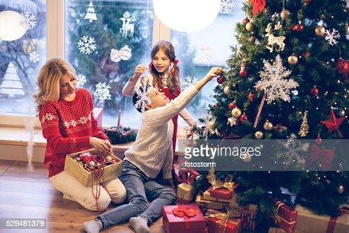 Family decorating Christmas tree