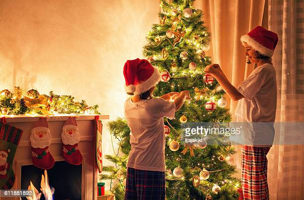 Decorating Christmas Tree Stock Photos And Pictures