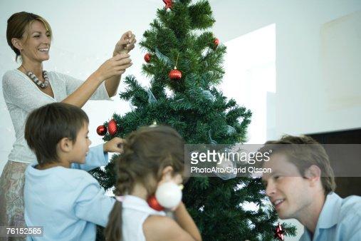 People Decorating For Christmas Inside Design Inspiration