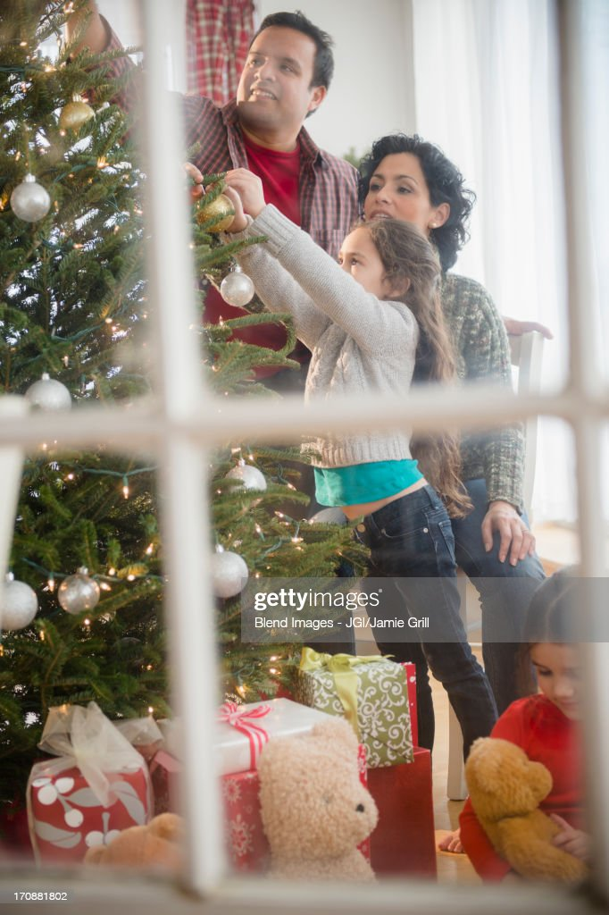 Family decorating Christmas tree together