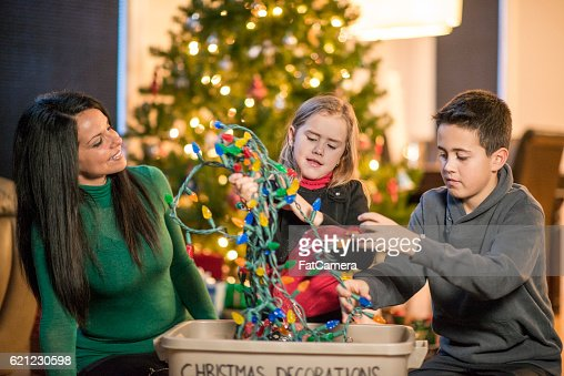People Decorating For Christmas family decorating for christmas stock photo | getty images