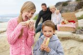 Family Dining Al Fresco At The Beach