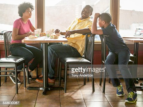 Family Dining At Fast Food Restaurant Stock Photo | Getty ...