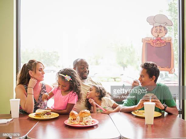 Family dining in fast food restaurant