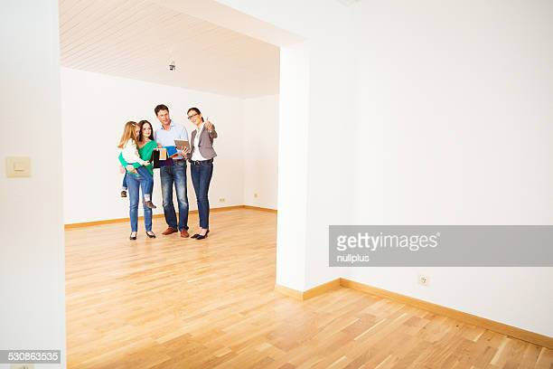 family discussing with their interior designer