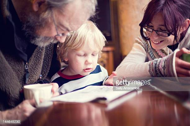 Family doing crossword puzzle together