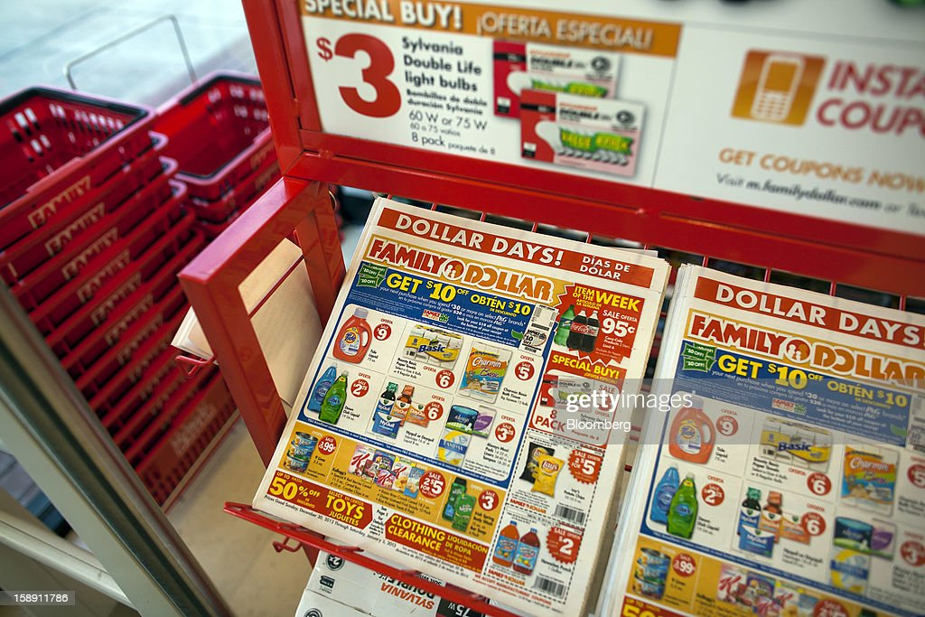 Family Dollar Stores Inc. advertisements are displayed near the entrance of a store in Belleville, New Jersey, U.S., on Thursday, Jan. 3, 2013. Family Dollar Stores Inc., the second-largest U.S. dollar store chain, tumbled the most in more than 12 years after cutting its fiscal 2013 earnings forecast, saying consumers are reluctant to spend on more-profitable discretionary items. Photographer: Michael Nagle/Bloomberg via Getty Images