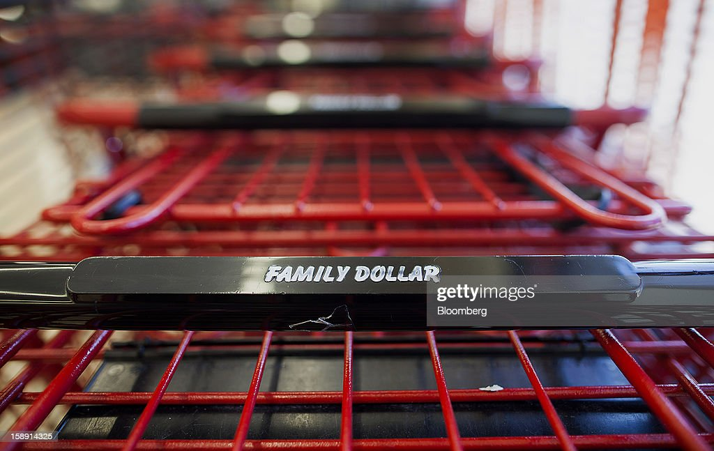 Family Dollar Stores Inc. signage is displayed on a shopping cart at a store in Belleville, New Jersey, U.S., on Thursday, Jan. 3, 2013. Family Dollar Stores Inc., the second-largest U.S. dollar store chain, tumbled the most in more than 12 years after cutting its fiscal 2013 earnings forecast, saying consumers are reluctant to spend on more-profitable discretionary items. Photographer: Michael Nagle/Bloomberg via Getty Images