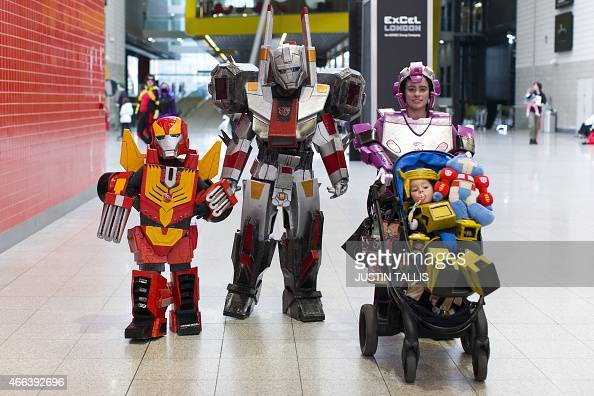 A family dressed as characters from the 'Transformers' franchise arrive on the second day of the London Super Comic Convention at the ExCel centre in...