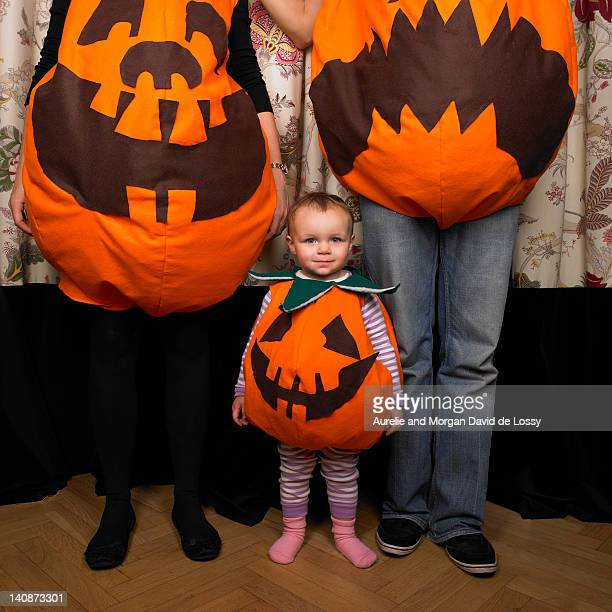 Family dressed as pumpkins for Halloween