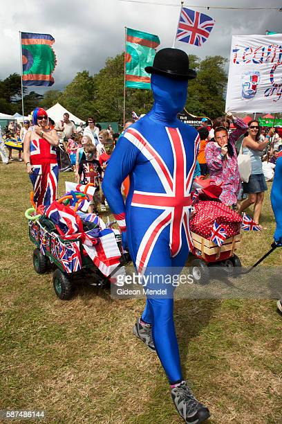 A family dressed in bizarre patriotic faceless Union Jack morph suits take part in the fancy dress parade at Camp Bestival Their costume is part of...