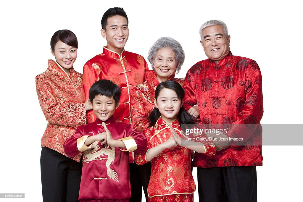 family dressed in traditional clothing celebrating chinese new year stock photo getty images. Black Bedroom Furniture Sets. Home Design Ideas
