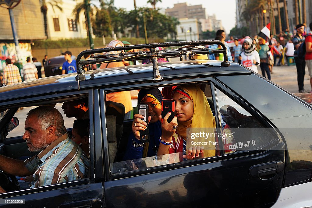 A family drives by Tahrir Square, the day after former Egyptian President Mohammed Morsi, the country's first democratically elected president, was ousted from power on July 4, 2013 in Cairo, Egypt. Adly Mansour, chief justice of the Supreme Constitutional Court, was sworn in as the interim head of state in ceremony in Cairo in the morning of July 4, the day after Morsi was placed under house arrest by the Egyptian military and the Constitution was suspended.