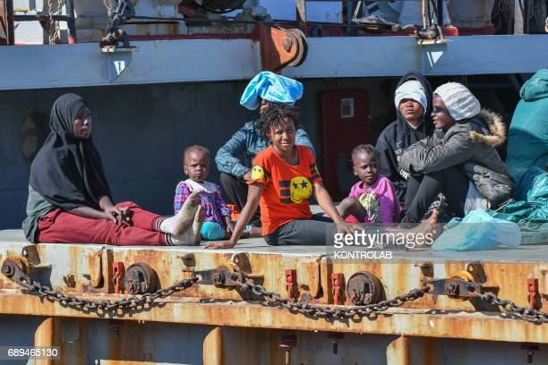A family during the landing of migrants by Turkish cargo ship Kaptan Hilmi III in port of Corigliano Calabria southern Italy The refugees disembarked...