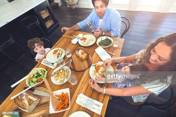 Family eating a meal at the table.
