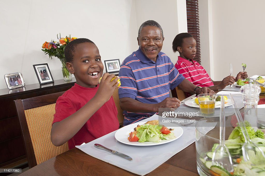 Family Eating At Dining Room Table Johannesburg South Africa Stock Photo
