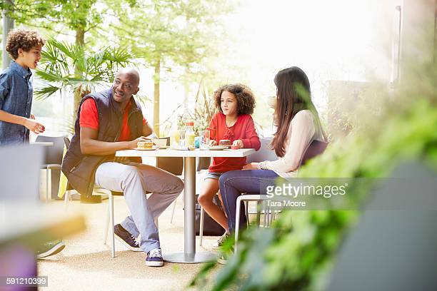 family eating at outdoor cafe