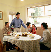 Family eating breakfast in dining room