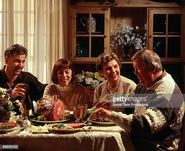 Family eating ham dinner