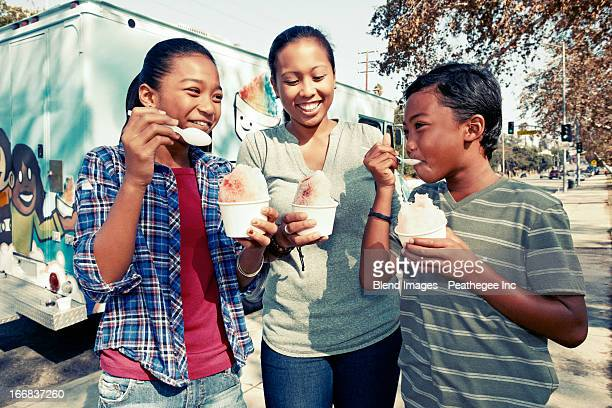 Family eating ice cream from truck