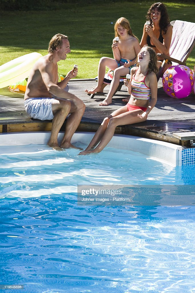 Family eating ice cream near swimming pool stock photo - Where is my nearest swimming pool ...