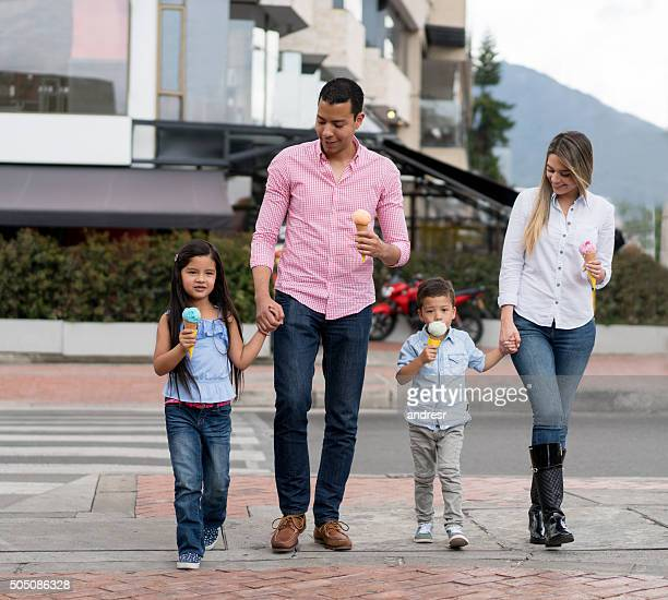 Family eating ice creams outdoors