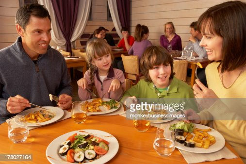 Family Eating Lunch Together In Restaurant : Stock Photo