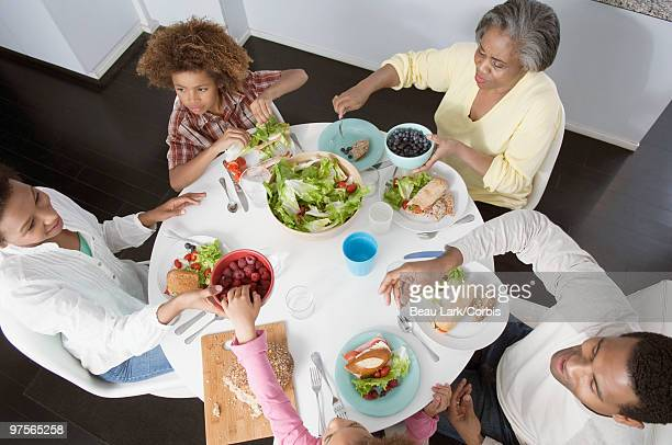 Family eating lunch together