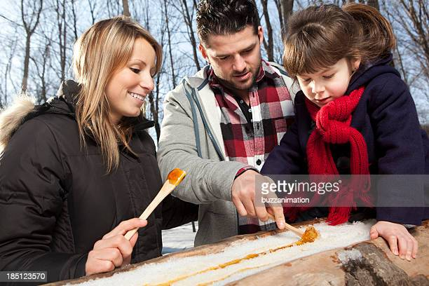 Family eating maple taffy