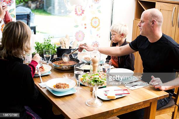 Family eating meal at restaurant
