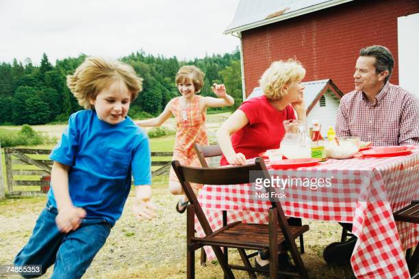 Family eating outdoors on farm