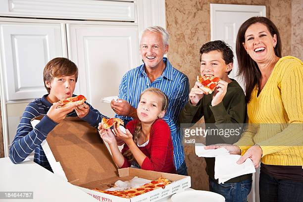 Family eating pizza from take-out box