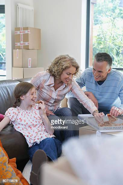 Family Eating Pizza in New Home