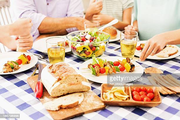 Family Eating Summer Lunch Together Outdoors