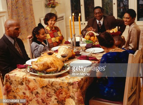 Family Eating Thanksgiving Dinner Stock Photo | Getty Images