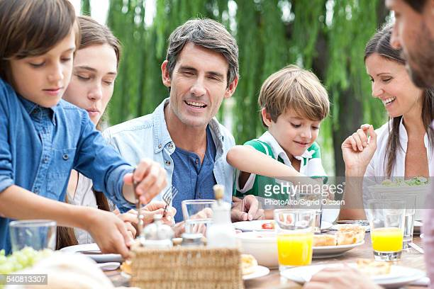Family Eating Outside Brunch Stock Photos an...