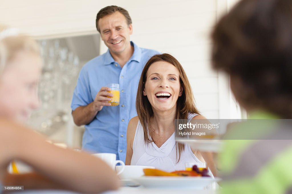 Family eating together at table : Stock Photo