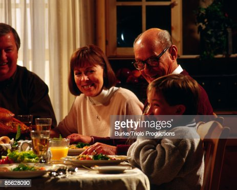 Family eating together : Stock Photo