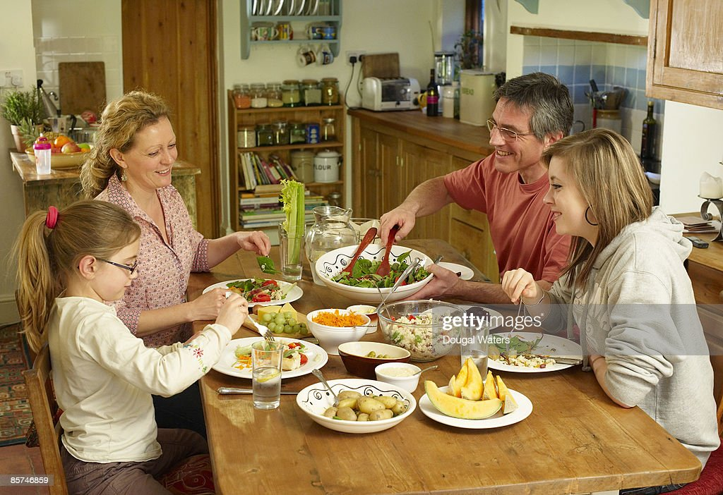 Family Eating Together Stock Photo   Getty Images